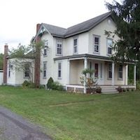 This Victorian on 15 acres in Ghent was built in 1875. It has a large living room with a massive fireplace, country kitchen with gas fireplace, formal dining room (also with fireplace), den, three large bedrooms and two and a half bathrooms. There is a new mahogany front porch and the back porch has a large deck. Walk outside to the lovely gardens and two streams. The rights to a private lake are shared by only a dozen homeowners. Listed for $699,000 by Old Ghent Real Estate.