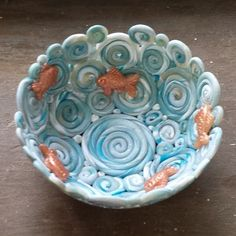 Penni Jo, of Best Flexible Molds, has a cute bowl project. Use some of your scraps and bits to build a coil bowl using a glass bowl as a slump mold. Next add precious little molded gold fish for de…