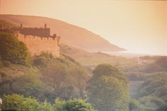 A superbly situated Country House in West Wales, overlooking Manorbier Bay and Castle in South Pembrokeshire. Pembroke Castle, Welsh Castles, Pembrokeshire Wales, Adventure Activities, What A Wonderful World, British Isles, Wonders Of The World, Monument Valley, National Parks