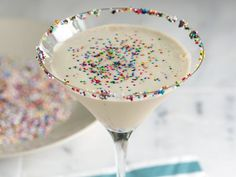 Sugar Cookie Martini (1 oz  vodka 1 oz chocolate liqueur 2 oz  Irish cream liqueur   2 oz  half-and-half   2 tsp butterscotch syrup 1/4 cup candy sprinkles)