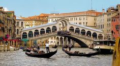 The Rialto Bridge is one of the four bridges spanning the Grand Canal in Venice, Italy. It is the oldest bridge across the canal. The present stone bridge, a single span designed by Antonio da Ponte, was completed in 1591 Venice Bridge, Grand Canal Venice, Rialto Bridge, Albania, Vacation Destinations, Dream Vacations, The Places Youll Go, Places To See, Piazza San Marco