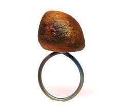Linda Ezerman. Ring: Imagine Your Beach…In Bloom, Series, 2012. Titanium, rubber, pigment, balsawood, laquer.