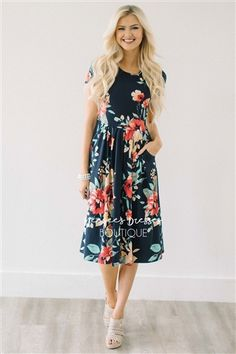 You can never have too many of our soft and comfy floral pocket dress! This navy dress features a pretty tropical floral print, has a cute pleated waist, short sleeves, and adorable front pockets!