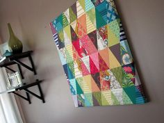 Twenty four inch canvas wrapped by triangle patchwork to make wall art