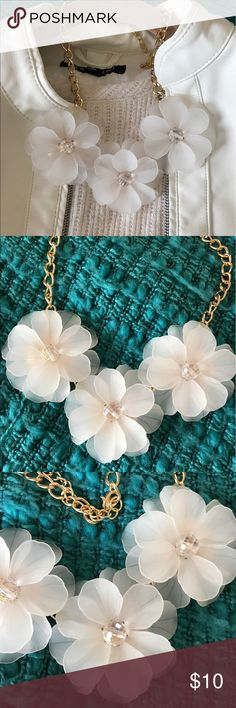 Necklace Spring is here and so are these beautiful flowers! Creamy white, they will be a great accessory to almost anything! Jewelry Necklaces
