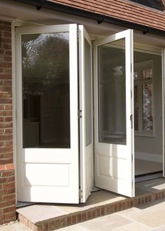 Our traditional range of timber windows and doors includes traditional sash windows and timber sash windows, entrance doors, French doors and more. French Doors, Cottage Exterior, Glass Garage Door, Folding Garage Doors, Bifold Doors, External Doors, Pole Barn House Plans, Garage Door Design, Folding Patio Doors