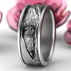A truly unique ring design that you wont see anywhere else! An adorable little owl poking its head out from the inside of a tree, this ring has tree bark texture that extends around the entire ring for a organic and intricate feel. Each ring is cast in solid sterling silver, and we