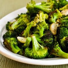 Roasted Broccoli with Garlic    1 bunch broccoli, about 1 1/2 pounds, cut into bite sized flowerets  3 T extra virgin olive oil  6-8 cloves fresh garlic (or more, I used about 12 cloves)  salt and fresh ground black pepper to taste
