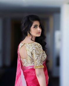 Looking for designer blouse patterns for sarees? Here are 15 most flattering models that will go well with any saree. Do try them and look chic. Pattu Saree Blouse Designs, Blouse Designs Silk, Designer Blouse Patterns, Bridal Blouse Designs, Blouse Back Neck Designs, Skirt Patterns, Coat Patterns, Dress Designs, Golden Blouse Designs