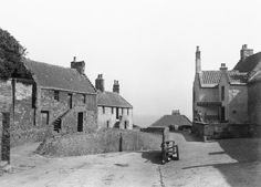 Old photo showing long gone century fishermen's cottages on the left next to castle wall - we are just round corner on opposite side of lane,towards the sea. Long Gone, Castle Wall, Butcher Shop, Old London, Round Corner, Far Away, 17th Century, Old Photos, Cottages