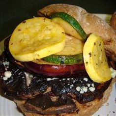 Grilled Veggie-Portobello Mushroom Burgers Allrecipes.com   Ingredients    6 large portobello mushroom, stems removed  1 eggplant, sliced into 1/2 inch rounds  1 medium yellow/summer squash, cut into 1/4-inch slices  1 zucchini, cut into 1/4-inch slices  1 (16 fl oz) bottle balsamic vinaigrette  1 (4 ounce) package crumbled blue cheese  6 hamburger buns, split and lightly toasted