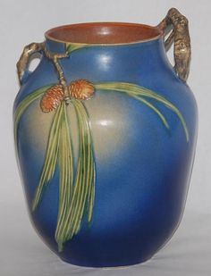 Roseville pottery. I love eclectic...old with new!  This piece has such beautiful simplicity and color