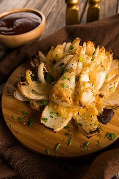 We're Traeger'ing up a simpler, healthier version of a steakhouse favorite. Loaded with parmesan and pepper jack cheese, this Grilled Blooming Onion is a delicious appetizer that looks as good as it tastes. Get the full recipe.