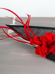 Shop the Cruella De Vil Black Fascinator at FORD MILLINERY. This black fascinator is finished with a white flower and feather. Silk Flowers, White Flowers, Spring Racing Carnival, Black Fascinator, Red Feather, Millinery Hats, Red Silk, Fascinators, Headpieces