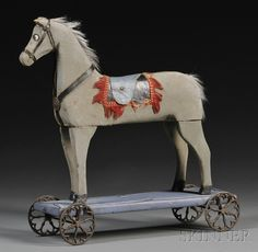 Folk carved and painted wooden horse pull toy.  American, late 19th, early 20th Century