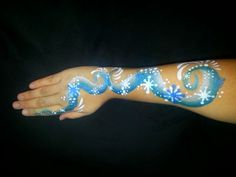 Winter snowflake arm swirl. Face painting. Face paint painter. Frozen.