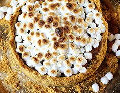 Making this decadent no-bake cheesecake is a great way to treat the people you love! Rich chocolate cheesecake with fabulous graham cracker crust and ooey gooey marshmallows!