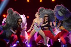 "Rosen: The 2013 VMAs Were Dominated by Miley's Minstrel Show | Cyrus's twerk act gives minstrelsy a postmodern careerist spin. Cyrus is annexing working-class black ""ratchet"" culture, the potent sexual symbolism of black female bodies, to the cause of her reinvention: her transformation from squeaky-clean Disney-pop poster girl to grown-up hipster-provocateur. (Want to wipe away the sickly-sweet scent of the Magic Kingdom? Go slumming in a black strip club.)"