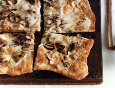 Easy pizza with mushrooms. I used fontina and Jamie Oliver's Pizza Dough recipe