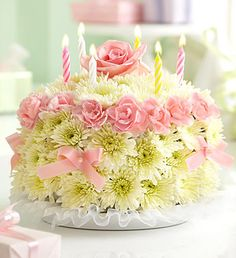 Birthday Flower Cake® Pastel- cake-shaped arrangement of pastel mini carnations and cushion poms in floral foam, topped with a single pastel rose $39.99- $79.99