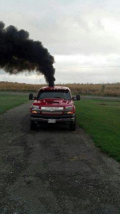 Grey Smoking lifted Chevrolet Silverado Duramax truck  Chevrolet