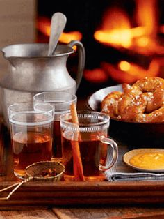 Hot apple cider (Country Living suggests spiked with champagne) is a timely and tasty soiree beverage.