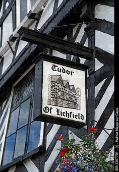 Old pub sign, Tudor of Lichfield, on a half-timbered Tudor-style house, Bore Street, Lichfield