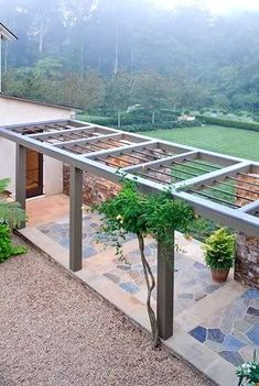 Modern walkway ~ A Modern Pergola Pergolas are romantic and charming. Create a modern minimalist pergola perfect for your garden. Modern Pergola, Outdoor Pergola, Backyard Pergola, Outdoor Rooms, Outdoor Living, Outdoor Benches, Pergola Carport, Cheap Pergola, Outdoor Sheds