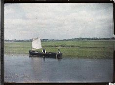 Currach transporting turf, river shannon, near Athlone. Old colour photos of Ireland in 1913