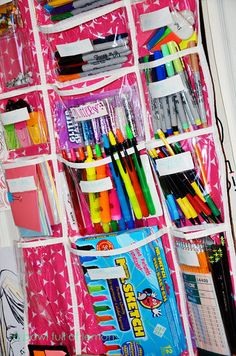 over the door supplies organizer. this needs to go on my laundry room door for coloring books, markers & dry erase boards & all the other crap the girls do non stop so my laundry room counter can be clear!