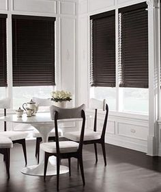 White on white wall molding with contrasting black shades.