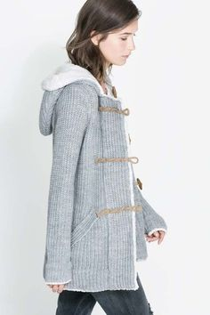 duffel sweater coat. Love the sweater even if this girl looks depressed.