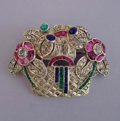 "BASKET brooch with red, green and blue rhinestones set in sterling, unmarked, 1-5/8""."