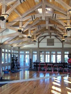 Metal strapping adds another dimension to hammer beam trusses in a New England exercise room.