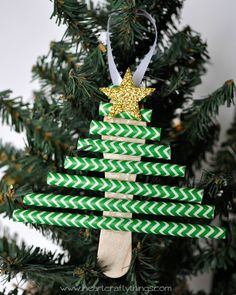 Christmas ornament crafts: Christmas tree ornament made from a decorative green paper straw. (Sold in a pack of 20 in the candy section at most craft stores.) I'd use a smaller green Popsicle stick & paint the bottom brown.