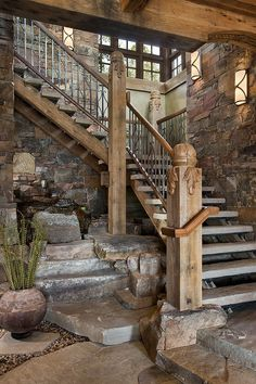 Rustic Staircase with Floating staircase, High ceiling, slate floors, Exposed beam, Metal railing, Interior stone wall