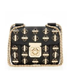 This trendy Chloe Elsie shoulder bag features textured black leather with elegant gold-tone metal and black crystal studs. An iconic turnlock closure and intricately twisted shoulder strap complete the look of this day-to-night accessory.