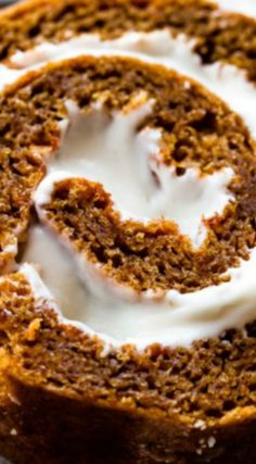 The BEST Pumpkin Roll ~ Absolutely delicious and easy... Moist, delicious, spiced, and filled with cream cheese frosting.