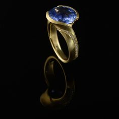 18ct yellow gold and 10ct blue sapphire with diamond detail. Made by McCaul Goldsmiths.