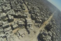 Destruction: This aerial view shows the destruction in the al-Khalidiyah neighbourhood of Homs, which has seen some of the heaviest fighting as government forces bid to flush rebels into the open  #syria #war #dailymail