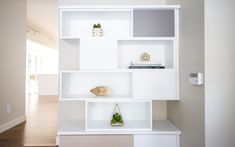 Custom shelves created to store a variety of items, memorabilia, books, and games. Living Room Cabinets, Living Room Storage, Media Room Design, California Closets, Bed Wall, Room Organization, Shelving, Family Room, Living Spaces