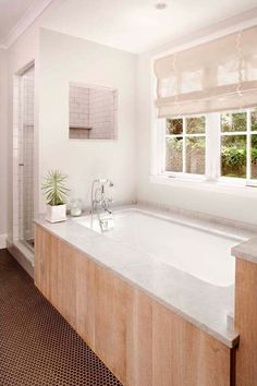 I seriously want this bathroom. Yes, and it fits my dream color combo - white and light wood.