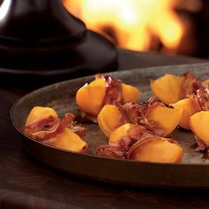 Roasted Persimmons Wrapped in Pancetta | Melon wrapped in ham is a classic starter—but tough to prepare in the winter, when melons are out of season. Instead, swap in these warm roasted persimmons for a sweet-salty holiday treat.
