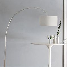 "LR - Floor Lamp - West elm - Overarching floor lamp with white shade - Dimensions: 19""w x 61""d x 77""h - Contents: Polished nickel base and arm; white linen shade - $249 retail  On/off foot switch. Accommodates a 60W incandescent bulb (sold separately). UL listed. Imported."