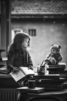 girl with a book and a bear.