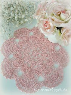 small pineapple doily in pink - there are links to several beautiful patterns on this site