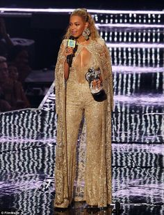 Shimmering: Beyonce looked fantastic in a gold number including jumpsuit and…