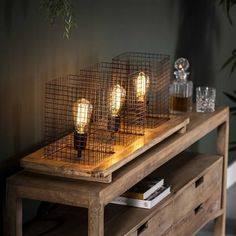 This industrial table lamp has three fittings and is made of solid mango wood. The wooden luminaire gives this table lamp a tough appearance. Different Light Bulbs, Drop Lights, Industrial Table, Glass House, Entryway Tables, Dining Table, Table Lamps, Mango, Metal