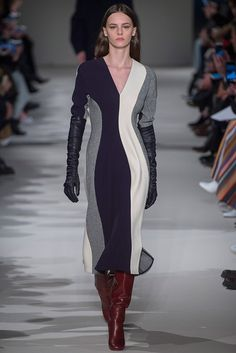 Victoria Beckham. Flow, colour - both flattering and what about those gloves!