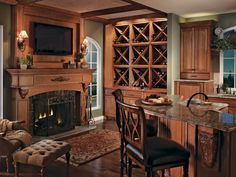 kitchen fireplace with corbels and flat screen